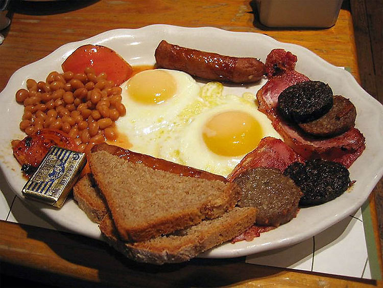 Full English – Sausages, bacon, eggs, grilled tomato, mushrooms, bread, black pudding and baked beans. Knocked back with a cup of tea.