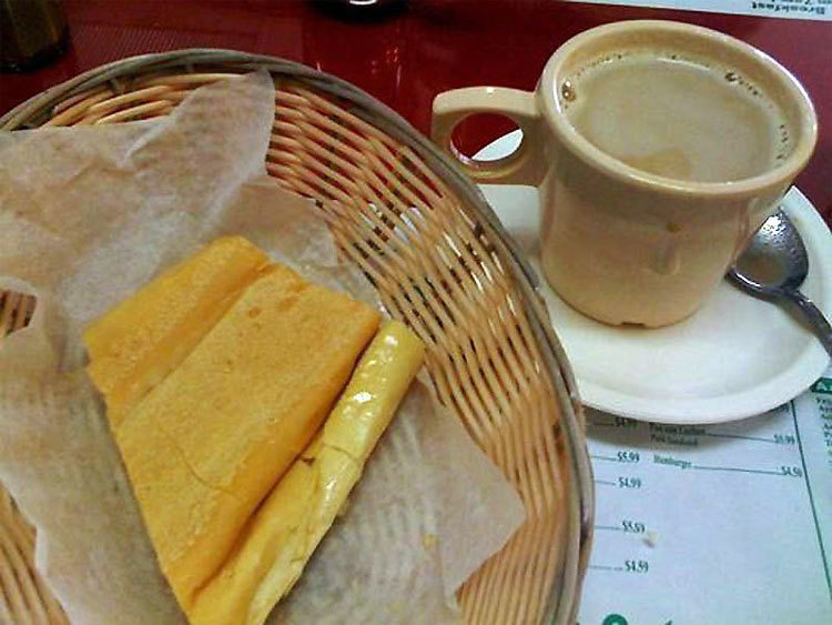 Cuba – Usually consists of sweetened coffee with milk with a pinch of salt thrown in. The unique Cuban bread is toasted and buttered and cut into lengths to dunk in the coffee.