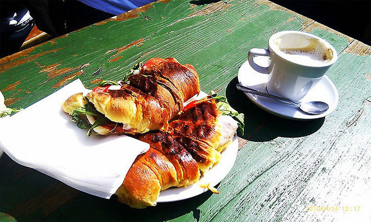 Portugal – Delicious and simple, stuffed croissants and plenty of coffee served in the sun.