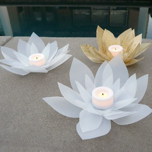 Cut plastic jugs into cool votive candle holders.