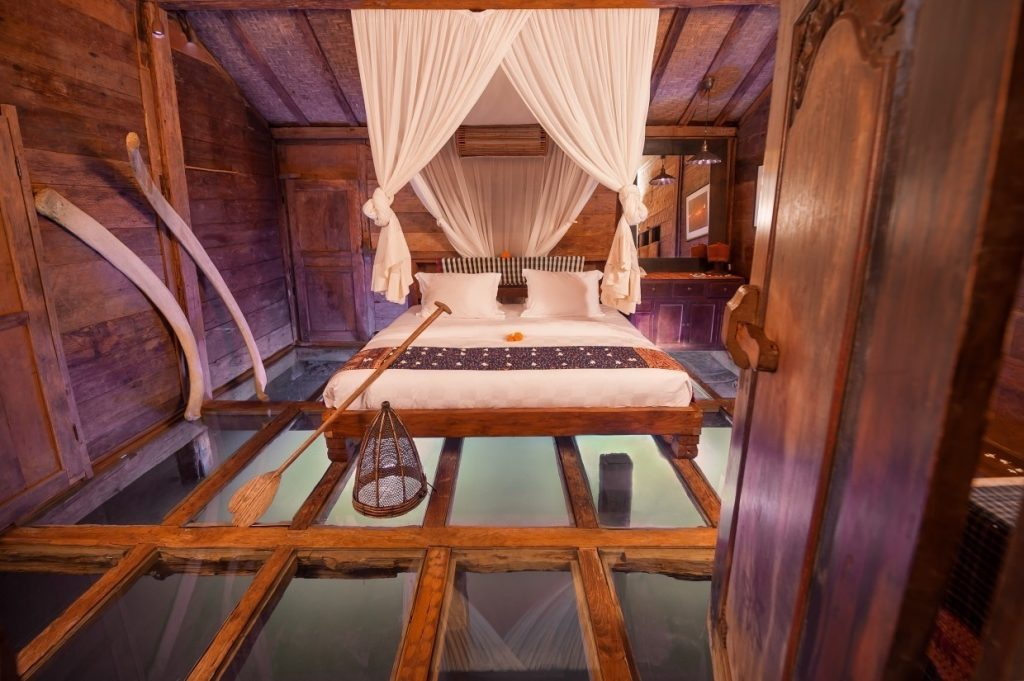 Situated above a fresh shrimp pond, this house has tempered glass floor panels for an underwater panorama of crustaceans in action. Authentic shrimp baskets have been converted into lamps for a total fishing village experience.