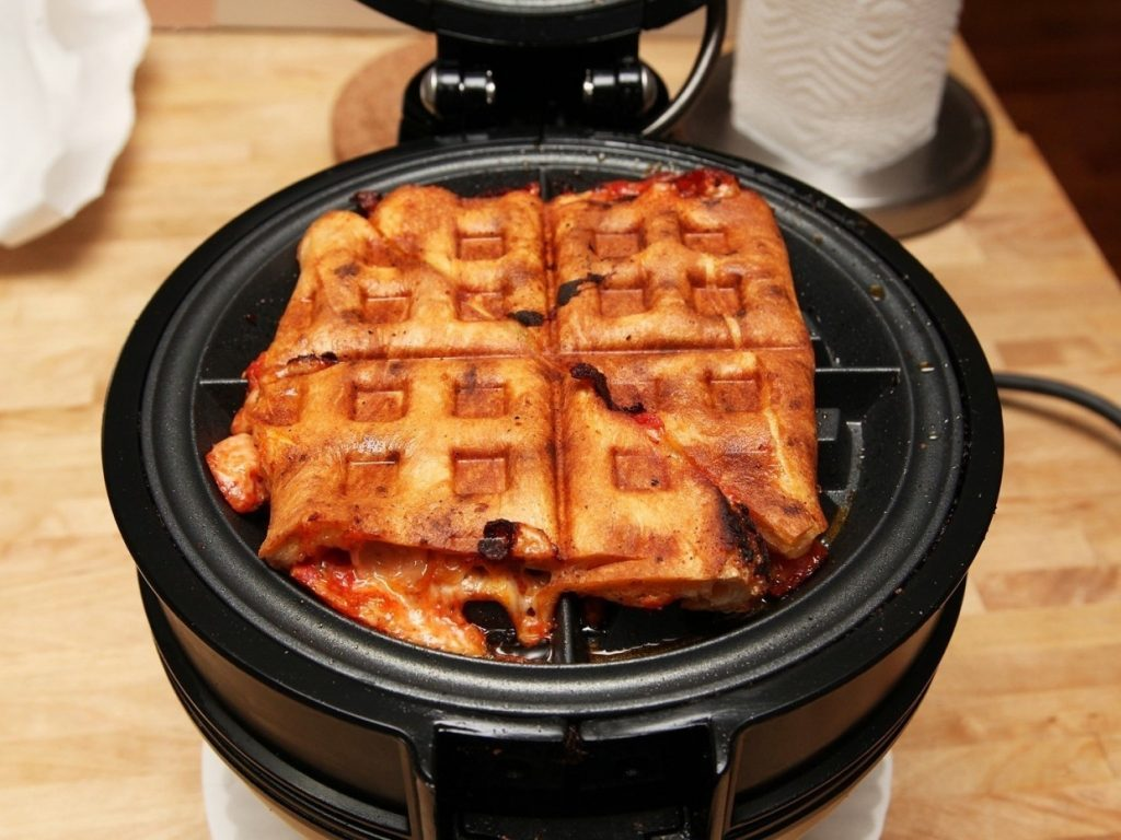 Use a waffle iron to heat up cold pizza.
